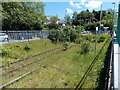 ST0381 : Overgrown track at the edge of Pontyclun railway station by Jaggery