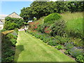 SW8458 : Herbaceous border at Trerice by David Hawgood