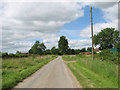 TM2390 : Minor road through Shelton Common by Evelyn Simak