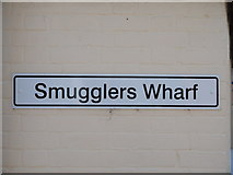 TM0321 : Smugglers Wharf sign by Hamish Griffin