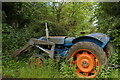 SJ6642 : Fordson tractor blocking field entrance, Wood Orchard Lane, Audlem by Christopher Hilton