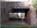 SO6931 : Under the bridge to the children's play area in Dymock by Jaggery