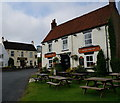 SE9136 : The Gnu and Tiger Inn's, North Newbald by Ian S