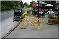 SD9760 : Yellow  Bike, Devonshire Arms, Cracoe by Ian S