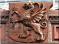 SJ3349 : Dragon shield on Wrexham Drill Hall by John S Turner