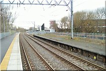 SJ8195 : Warwick Road railway station / Old Trafford tram stop, Manchester by Nigel Thompson