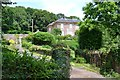 SX8465 : Coombe Fishacre House, gates, drive and garden, Combe Fishacre by Robin Stott