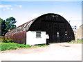 TF9038 : Old RAF workshop by Evelyn Simak