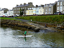 C8540 : Man on surfboard, Portrush by Kenneth  Allen
