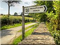 SK9224 : National Trust Signpost for Woolsthorpe Manor by David Dixon