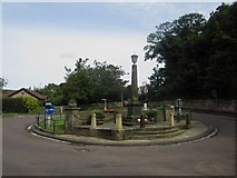 NU2410 : Roundabout and war memorial, Alnmouth by Graham Robson