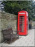 NU2410 : Telephone box and bench, Northumberland Street, Alnmouth by Graham Robson