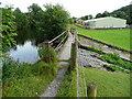SD8165 : Footbridge over reservoir overflow channel by Humphrey Bolton
