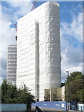 TQ2081 : Scaffolding shrink-wrapped during high-rise construction by David Hawgood