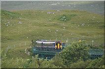NN4258 : Train crossing the Rannoch viaduct at Rannoch Station by Mike Pennington
