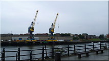 NZ4057 : Dockside cranes at Sunderland Harbour on the River Wear by Jeremy Bolwell