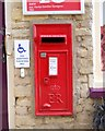 TF1205 : Wall-mounted EIIR postbox at Helpston Post Office by Paul Bryan