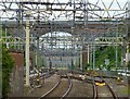 SP9512 : Gantries and bridge at Tring Station by Rob Farrow