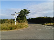 SX0479 : Crossroads and signpost by Rob Purvis