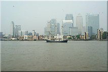 TQ3880 : View of Thalassa passing Canary Wharf by Robert Lamb