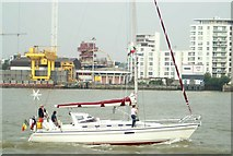 TQ3880 : View of a yacht passing the Greenwich Peninsula by Robert Lamb