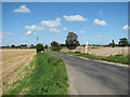 TG2525 : Unnamed road to Skeyton Corner by Evelyn Simak