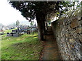 SS9091 : Path along the southern perimeter wall of Gelliron Cemetery, Pontycymer by Jaggery