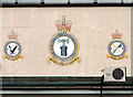 TG2623 : Squadron badges on hangar 2 by Evelyn Simak