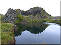 NM7414 : Reflections in a flooded quarry at Cuan Point by Oliver Dixon