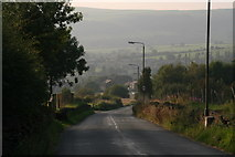 SK0296 : Main Road out of Padfield towards Tintwistle by Chris