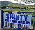 NN7098 : A banner at Newtonmore Shinty Ground by Walter Baxter
