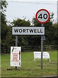 TM2885 : Wortwell Village Name sign on High Road by Adrian Cable