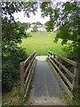 SX4759 : Footbridge in Woodland Woods by David Smith