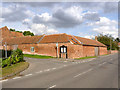 SK7685 : Farm buildings on Low Street by Alan Murray-Rust