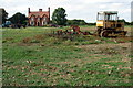 TL0946 : Farm machinery in front of Pasture Farm by Philip Jeffrey