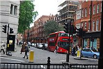 TQ2878 : Red London Bus, entering Sloane Square by N Chadwick