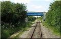 SP6625 : A footbridge over the line by Steve Daniels