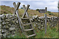 NY5316 : Stile and signpost on the Coast-to-Coast path by Nigel Brown