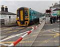 SJ3033 : Train on Gobowen level crossing by Jaggery