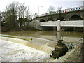 SP3065 : The River Leam engulfs the weir at Edmondscote, Leamington by Robin Stott