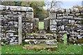 NY6215 : Stone stile and waymark by Jim Barton