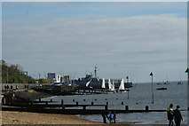TQ8485 : View along the groynes on the beach from the jetty by Robert Lamb