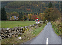 NN8048 : Minor road leading to the village of Dull by Ian S