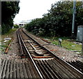 SZ3295 : End of the third rail near a Lymington level crossing by Jaggery