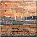 SK6587 : Bench mark on the Blue Bell Inn Ranskill by Alan Murray-Rust