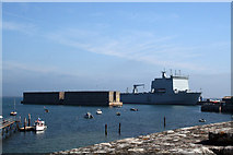 SY6874 : Mulberry Harbours and L3008 Royal fleet auxiliary amphibious assault vessel, Mounts Bay in Portland Harbour by Jo Turner