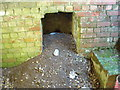 SU0669 : Fireplace in bunker, WW2 gun emplacement in round barrow, north of West Down by Vieve Forward