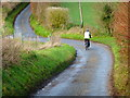 SU6517 : Pedal cyclist approaches junction of unnamed minor roads by Shazz