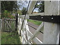 NY7786 : Level Crossing and Pedestrian Gates at Thorneyburn Station by Les Hull