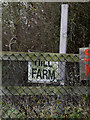 TL2762 : Hill Farm sign by Adrian Cable